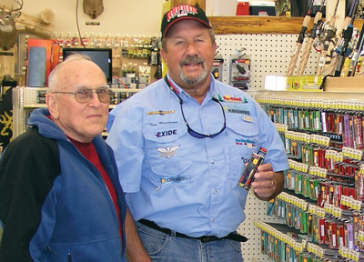 Professional Fishing Guide Tom Neustrom suggests a Rapala Crankbait to a customer at L&M Supply in Grand Rapids, Minnesota.
